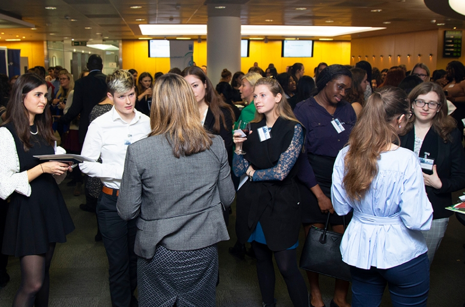 Room full of female-identifying individuals networking during a Cityview event