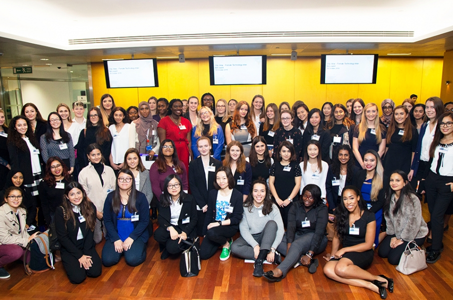 Whole cohort of female-identifying students posing together for a photo at a Cityview event