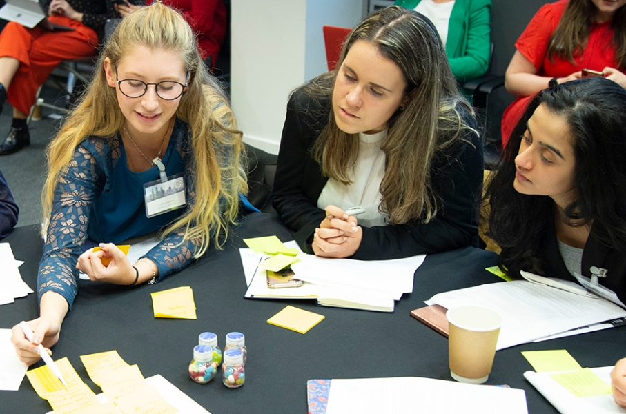 Three female-identifying students working together during a Cityview event