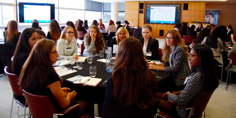 Group of female-identifying students sitting and conversing at a Stand Out event