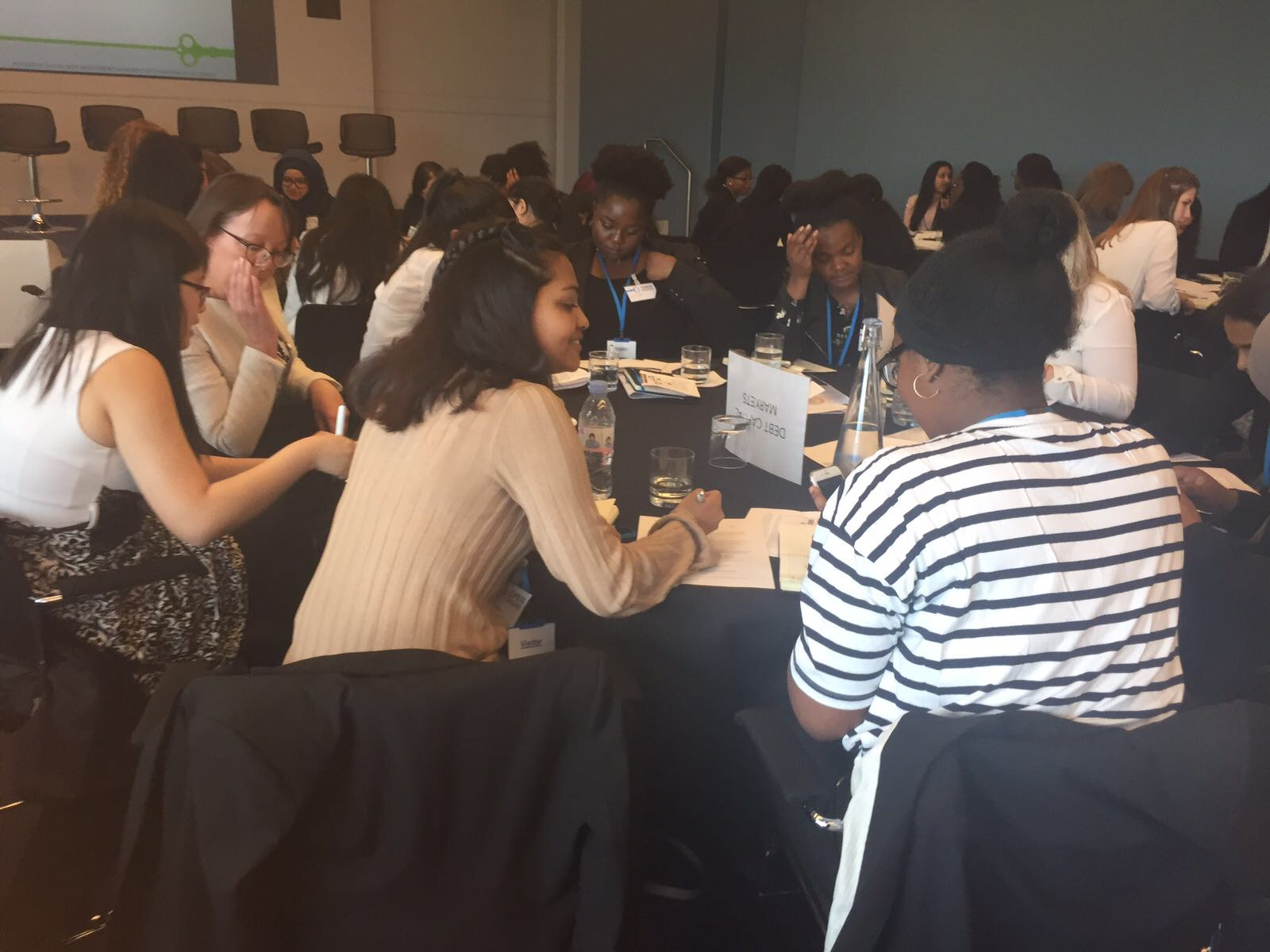 Group of female-identifying students sitting and working together at an Open Doors event.