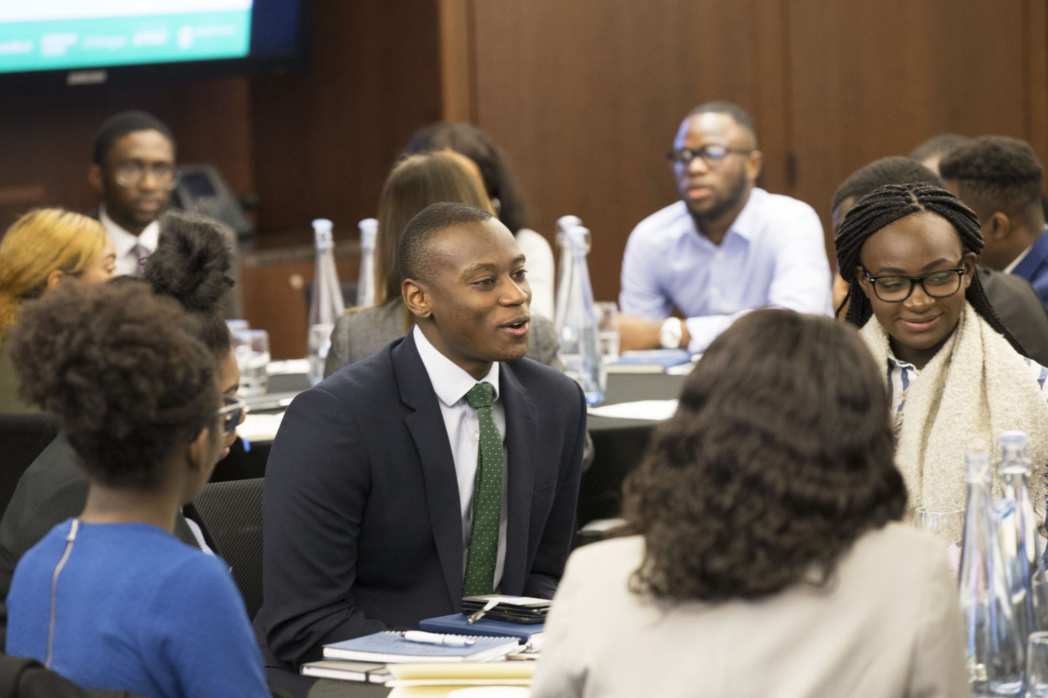Group of diverse students engaging in conversation during an Uncovering Prospects event