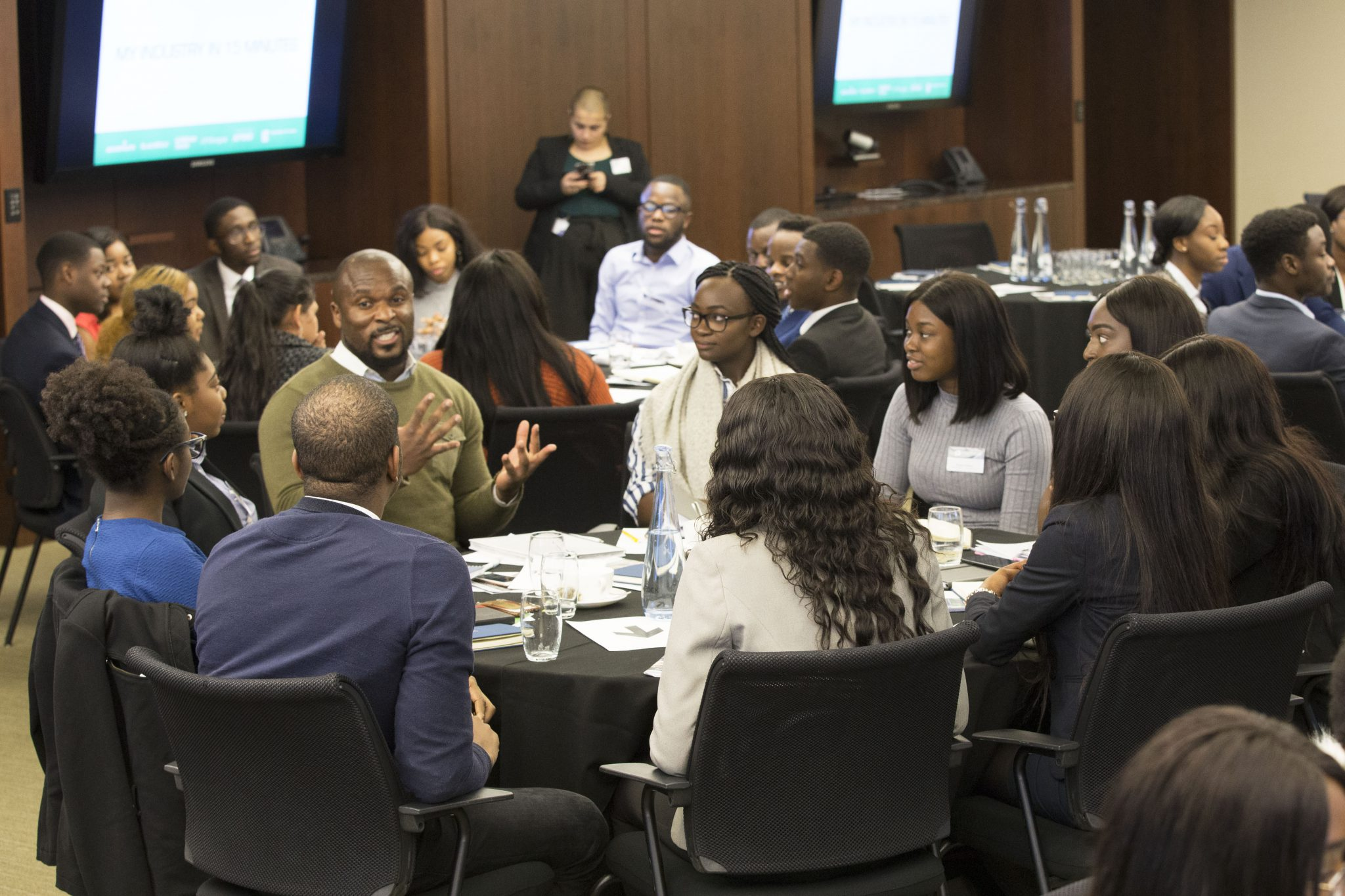 Group of diverse students sitting and conversing during an Uncovering Prospects event