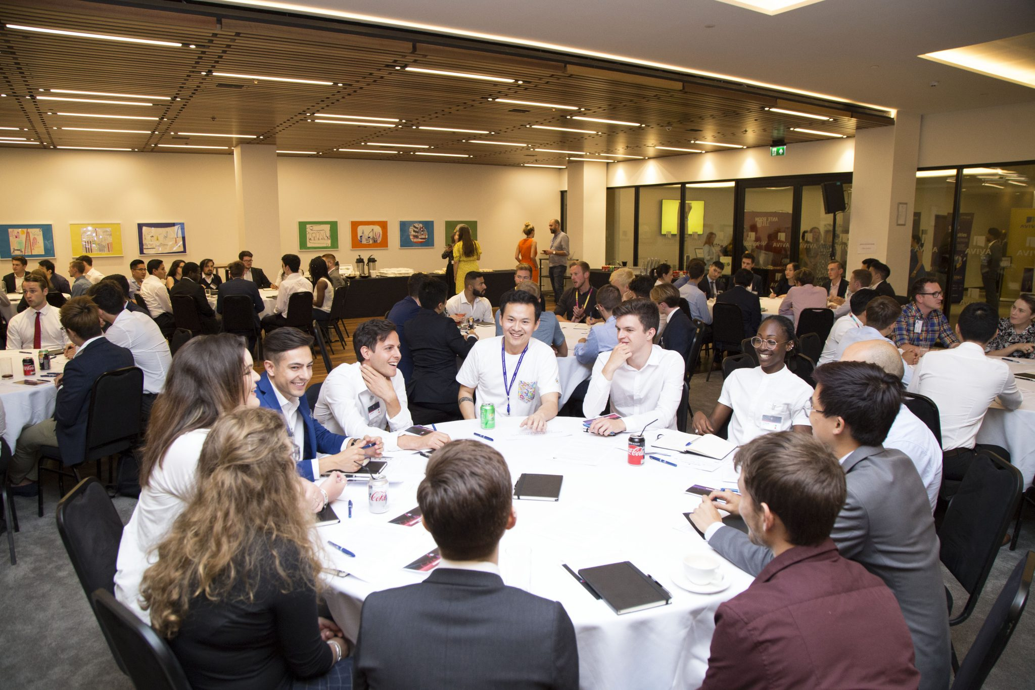 Group of students sitting around a table and engaging in conversation at an AuthentiCity event