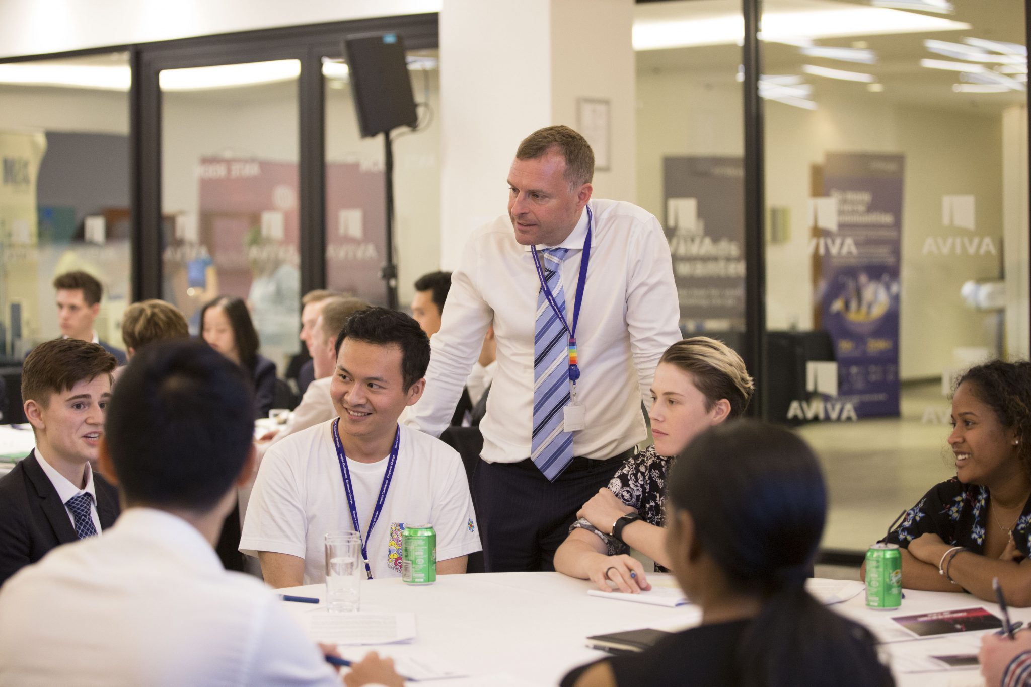 Group of students sitting together with an event organiser joining them in conversation during an AuthentiCity event
