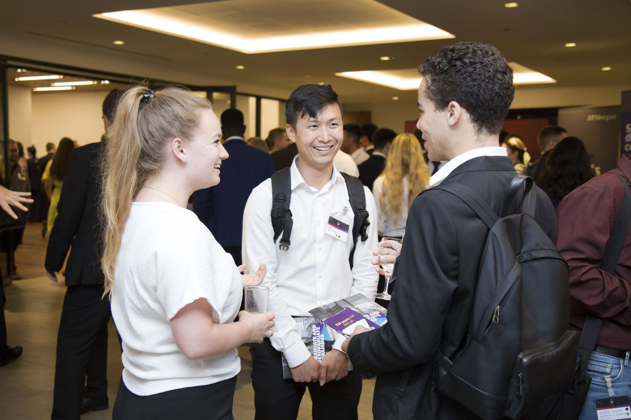 Three students networking and laughing at AuthentiCity