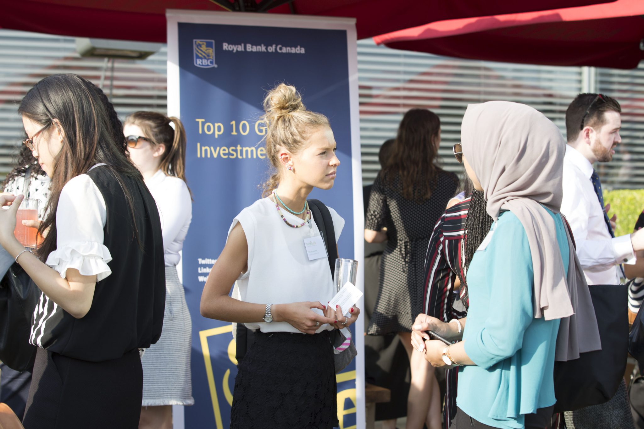 Group of people gathering outside and networking during a FreshLook event